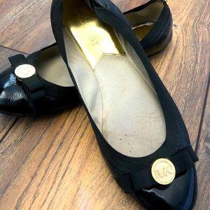 Michael Kors patent leather black flats.